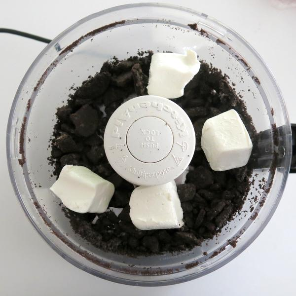 Oreos and cream cheese in a food processor
