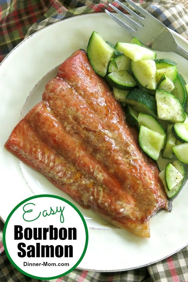 Easy Baked Bourbon Salmon will become your new favorite way to enjoy this healthy fish! The marinade can be used on chicken too! #bourbonsalmon #seafoodrecipes