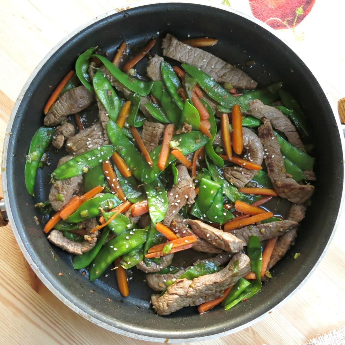 Asian beef stir fry in skillet