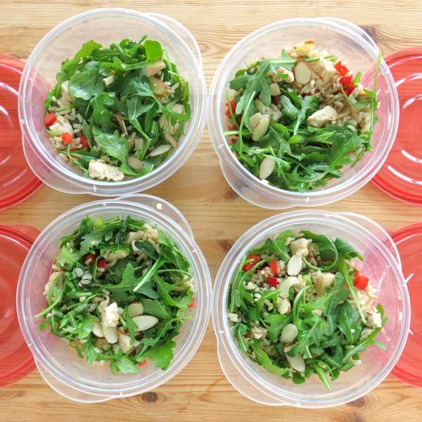 Cold Chicken Arugula Rice Salad in 4 containers next to lids for lunches