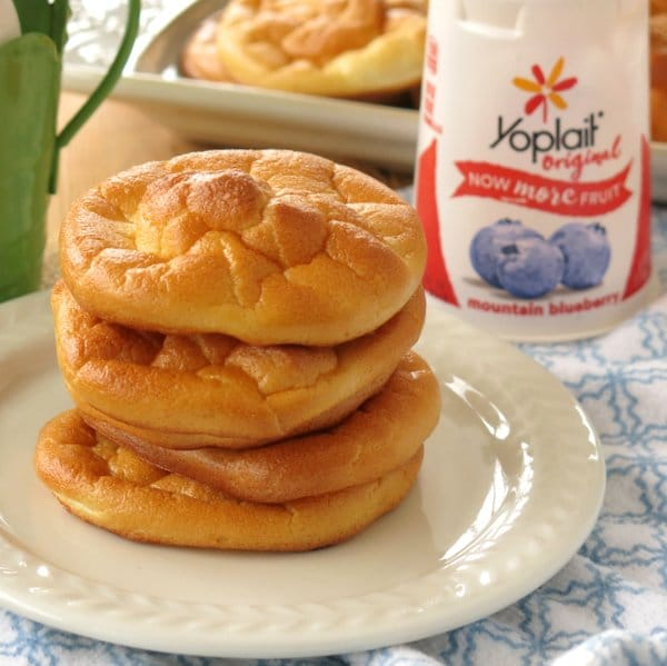 Stack of blueberry cloud bread on plate with Yoplait container behind it