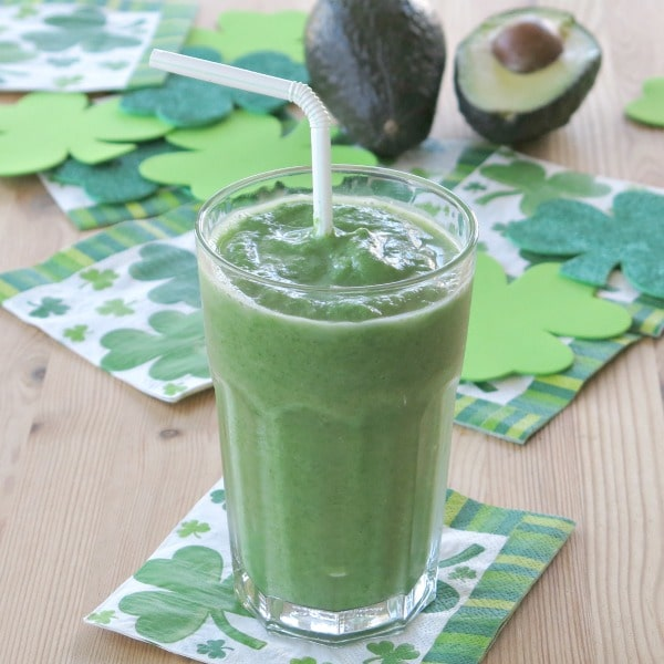 Avocado green smoothie recipe in glass with straw