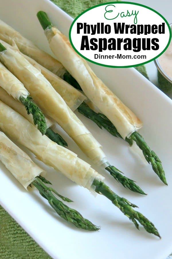 Phyllo Wrapped Asparagus is an easy appetizer or side dish that's perfect for spring or Easter! Just cut dough into strips, lightly brush with butter, roll it up and bake! It's over the top when dipped in lemon garlic aioli. #asparagus #healthyappetizer