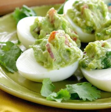 Guacamole Stuffed Deviled Eggs on plate