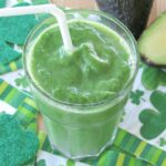 Pineapple green smoothie recipe in glass with straw
