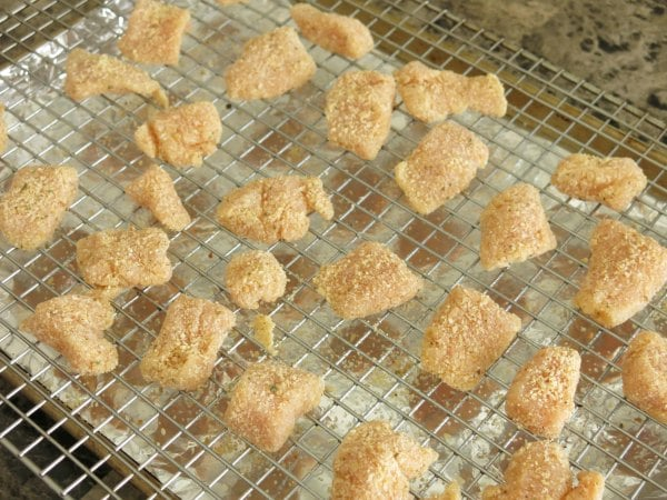 Uncooked Chicken Nuggets on baking sheet