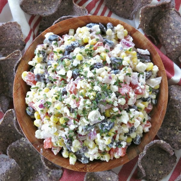 Easy Mexican Street Corn Dip in bowl surrounded by chips