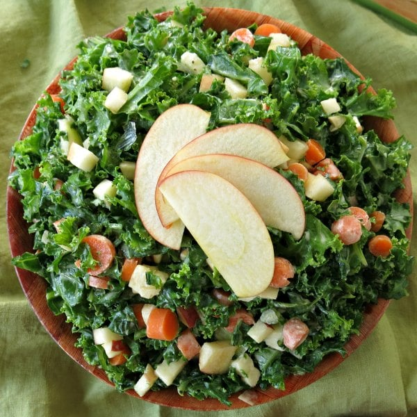 Kale Apple Slaw in bowl with apples fanned on top