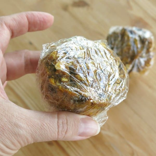 Oatmeal Pumpkin Muffin wrapped in plastic wrap