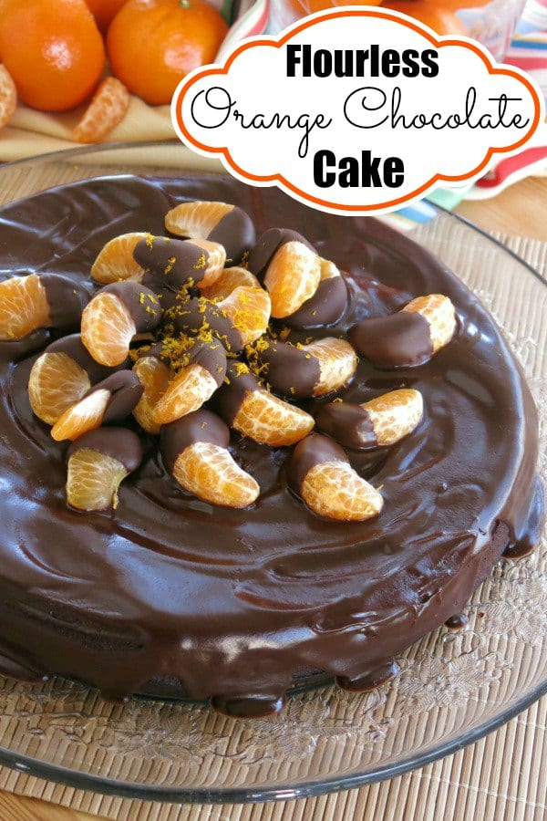 Flourless Orange Chocolate Cake is transformed with an easy chocolate substitution! Top it with chocolate ganache and chocolate dipped clementines for a  gluten-free, show stopper dessert. #flourlesscake #glutenfree