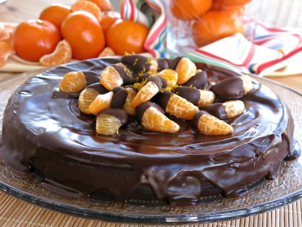 Orange Flourless Chocolate Cake with chocolate dipped clementines on top