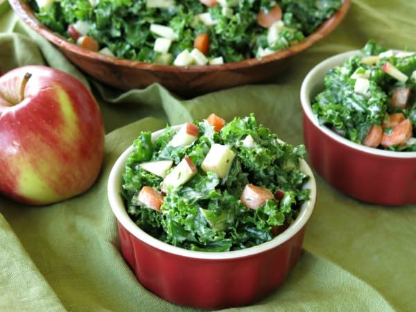 Kale and Apple Salad in small bowl with large bowl behind it
