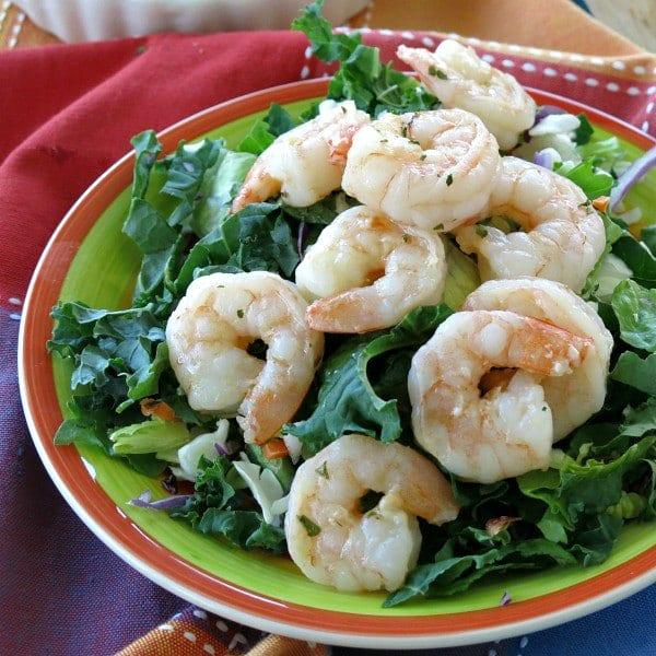 Skillet Shrimp on top of salad salad greens