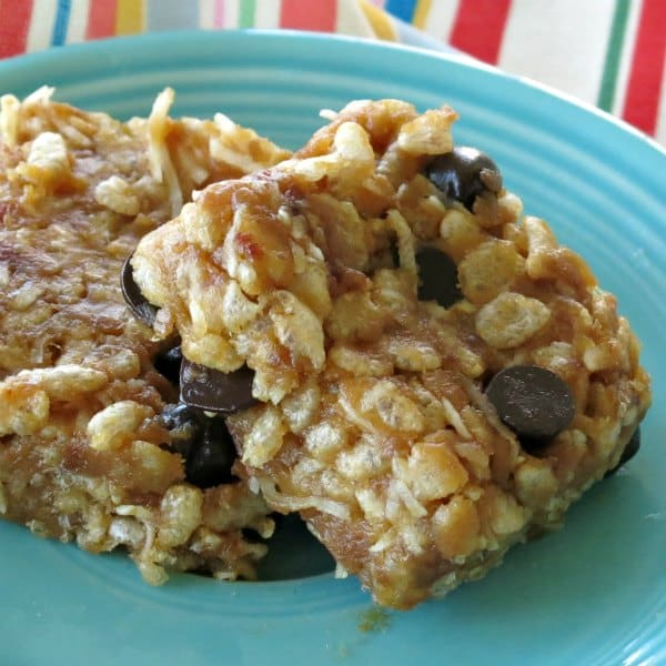 Two Almond Butter Rice Krispies Treats on a blue plate.