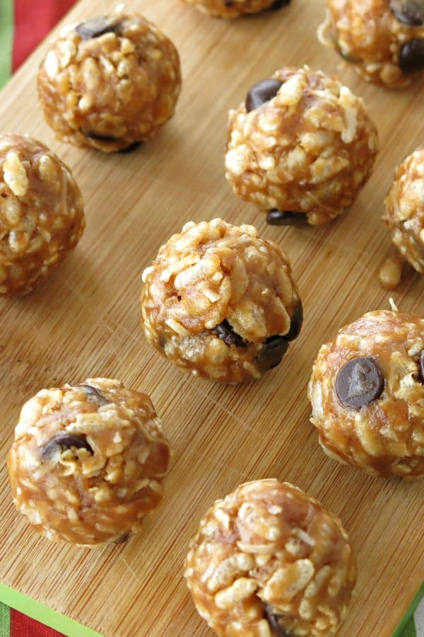 Rice Krispies Date Balls on a cutting board.