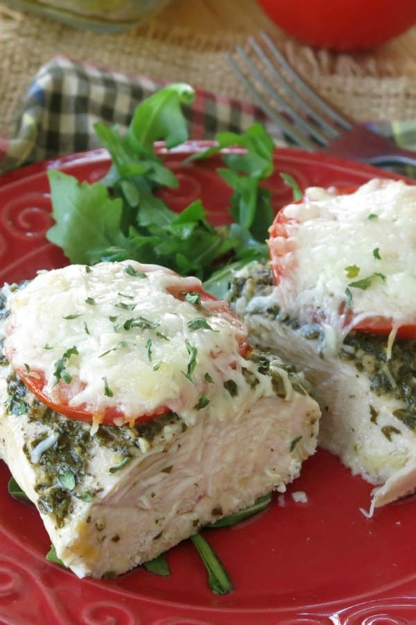 Healthy Chicken Pesto Recipe on plate cut in half