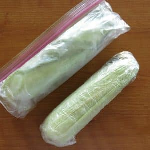 corn on the cob in plastic bag and wrapped in plastic wrap