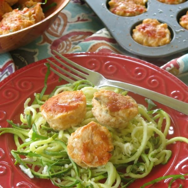 chicken meatballs and garlic parmesan zucchini noodles on a plate with fork
