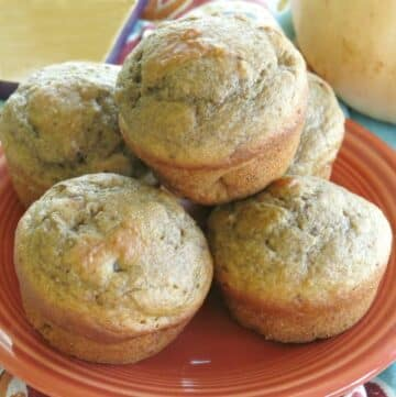 Butternut Squash Muffins with apple and walnuts stacked on a plate