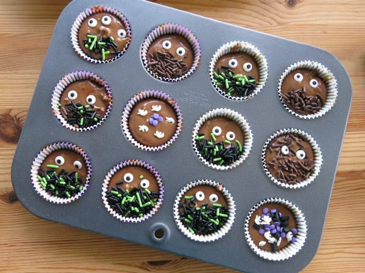 Easy Halloween decorated with sprinkles in a mini muffin tin ready for freezer