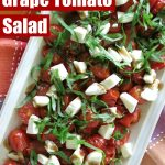 Roasted Grape Tomato Salad on a long rectangular plate