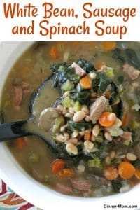 White Bean Sausage Spinach Soup being ladled from bowl with text for Pinterest