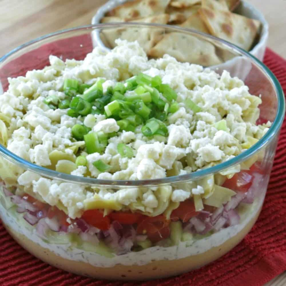 Greek Layered Dip with Tzatziki and other layers showing
