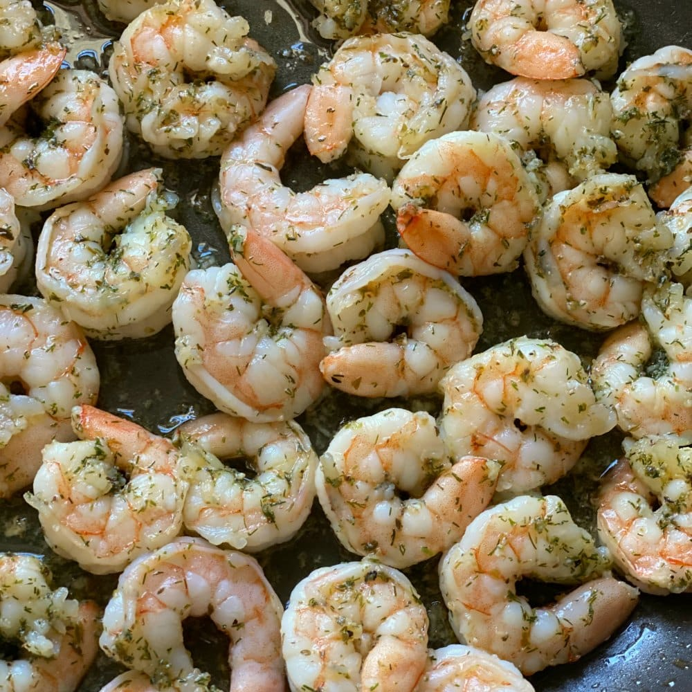 Perfectly cooked Greek shrimp in a skillet.