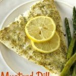 Baked Turbot cooked in mustard dill lemon glaze on plate with asparagus with word for pinterest