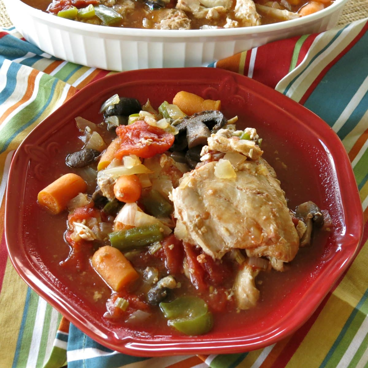 Slow Cooker Chicken Cacciatore with vegetables on a plate.