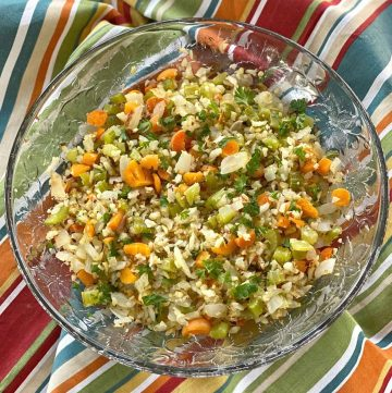 cauliflower rice pilaf with vegetables in a bowl.C