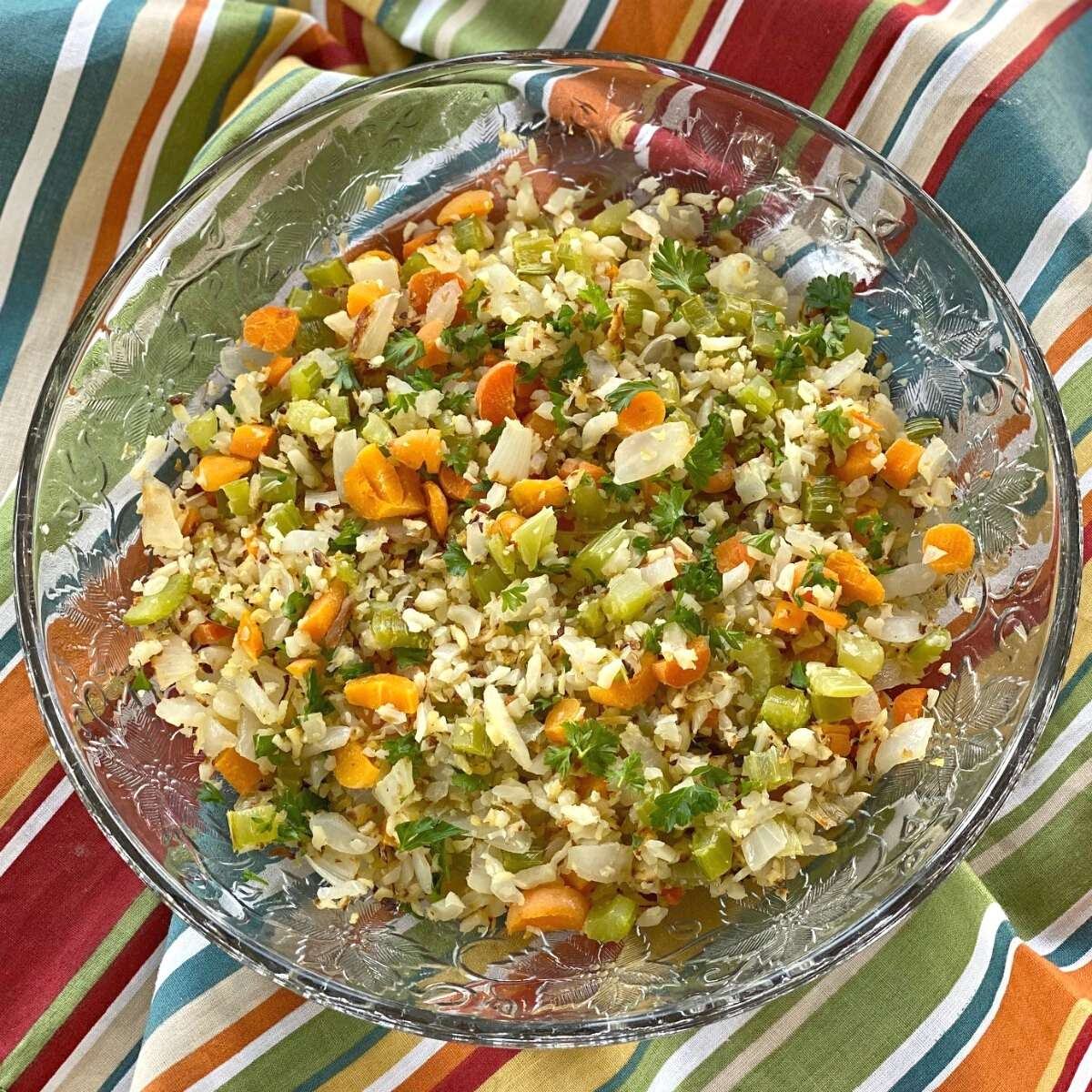 Cauliflower rice pilaf with vegetables in a bowl.