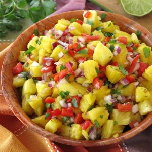 Easy Pineapple Salsa in a large wooden bowl.