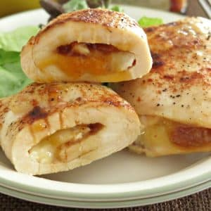 Three Mango Chutney Chicken and Brie Roll-ups on a plate.