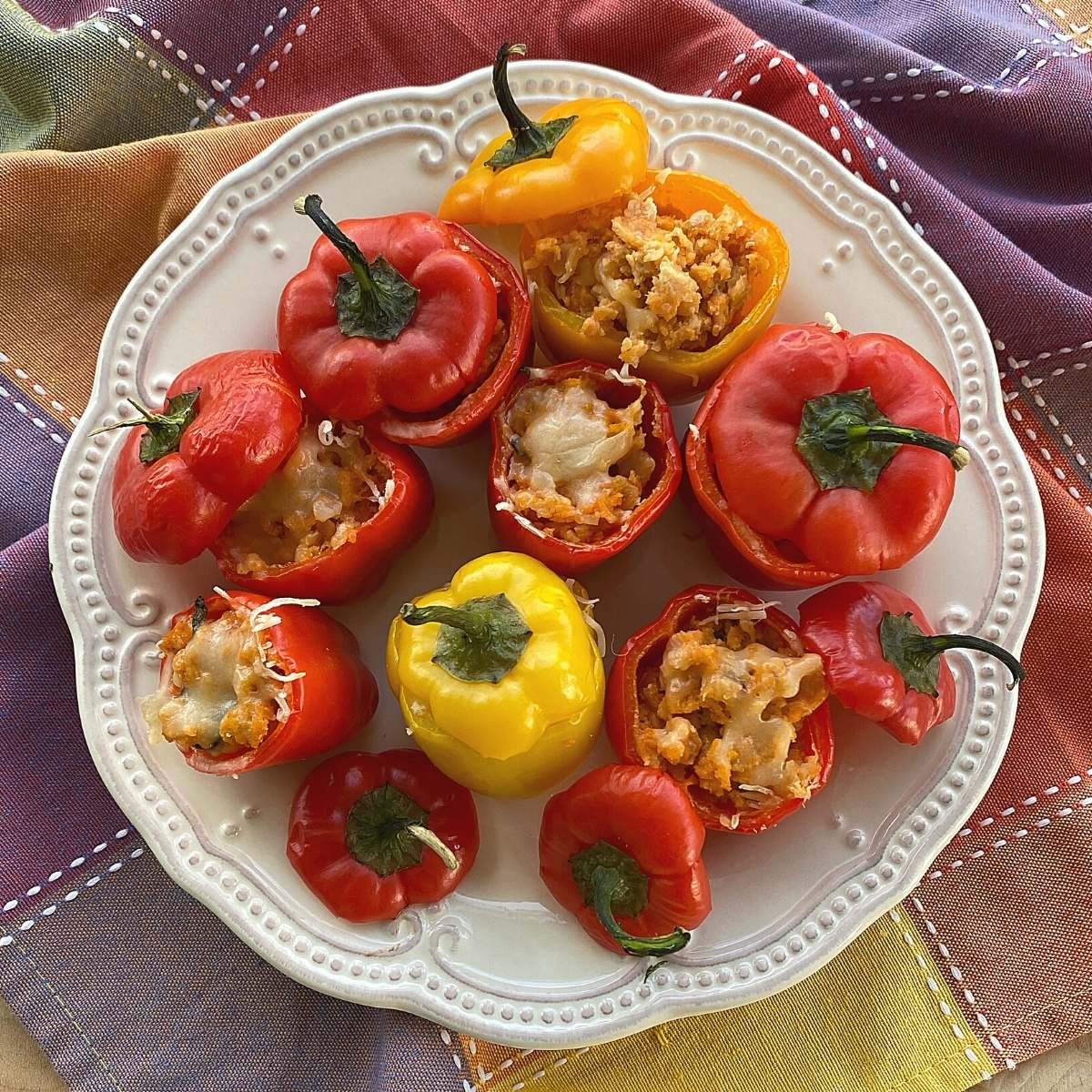 Plate of cooked baby bell peppers stuffed with leftover meatloaf.