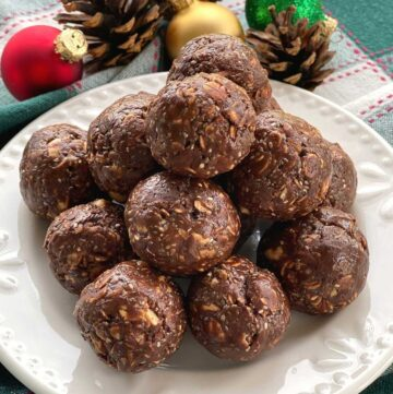 Plate of chocolate bliss balls made with hot honey, almond butter and chia seeds.