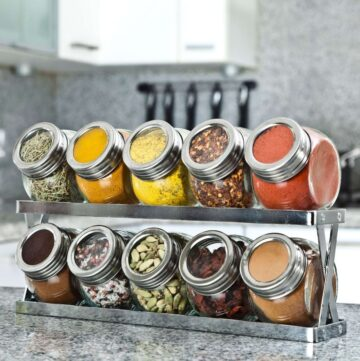 Spices organized on a spice rack in a kitchen