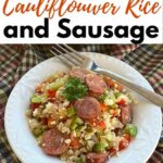 Bowl of Cajun Cauliflower Rice and sausage with fork on side and title on the top.