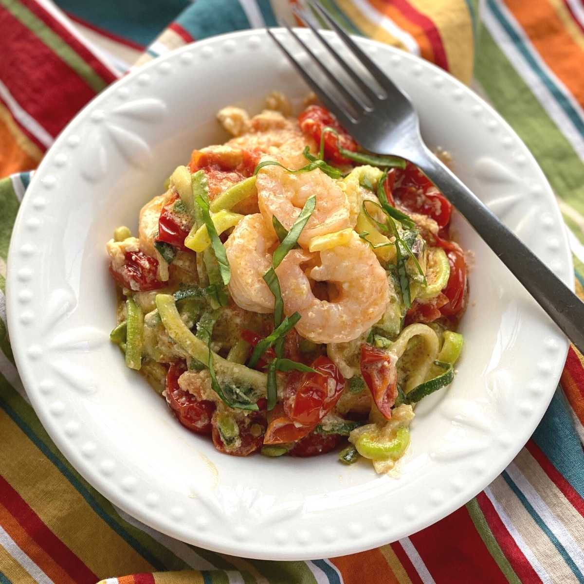 Viral Tik Tok Baked Feta Zoodles and Shrimp in a bowl with a fork.