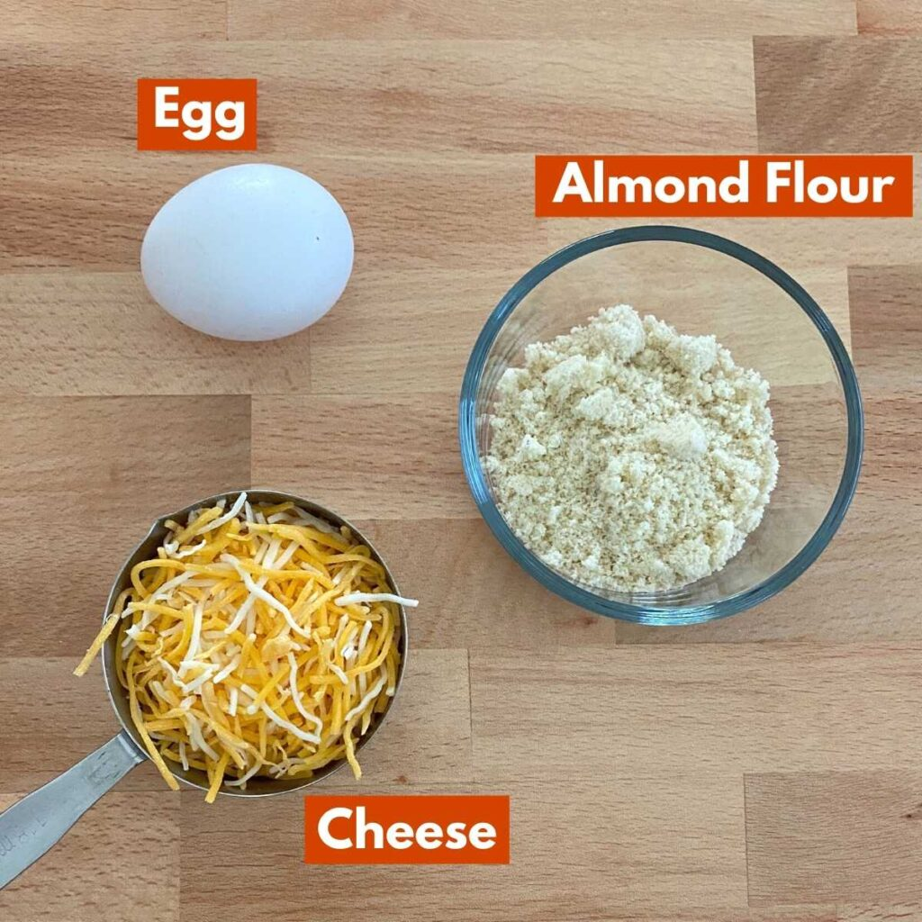Labeled graphic of ingredients to make recipe: egg, cheese and flour.