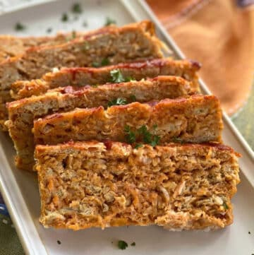 Slices of ground chicken meatloaf on a platter.