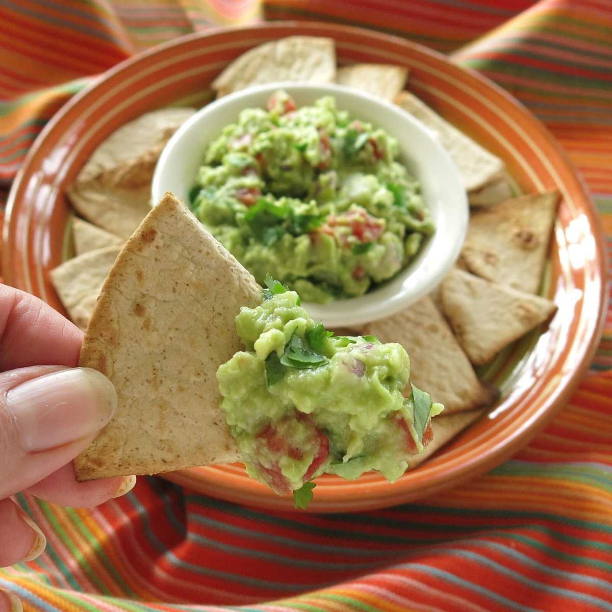 Guacamole on a homemade low-carb tortilla chip.