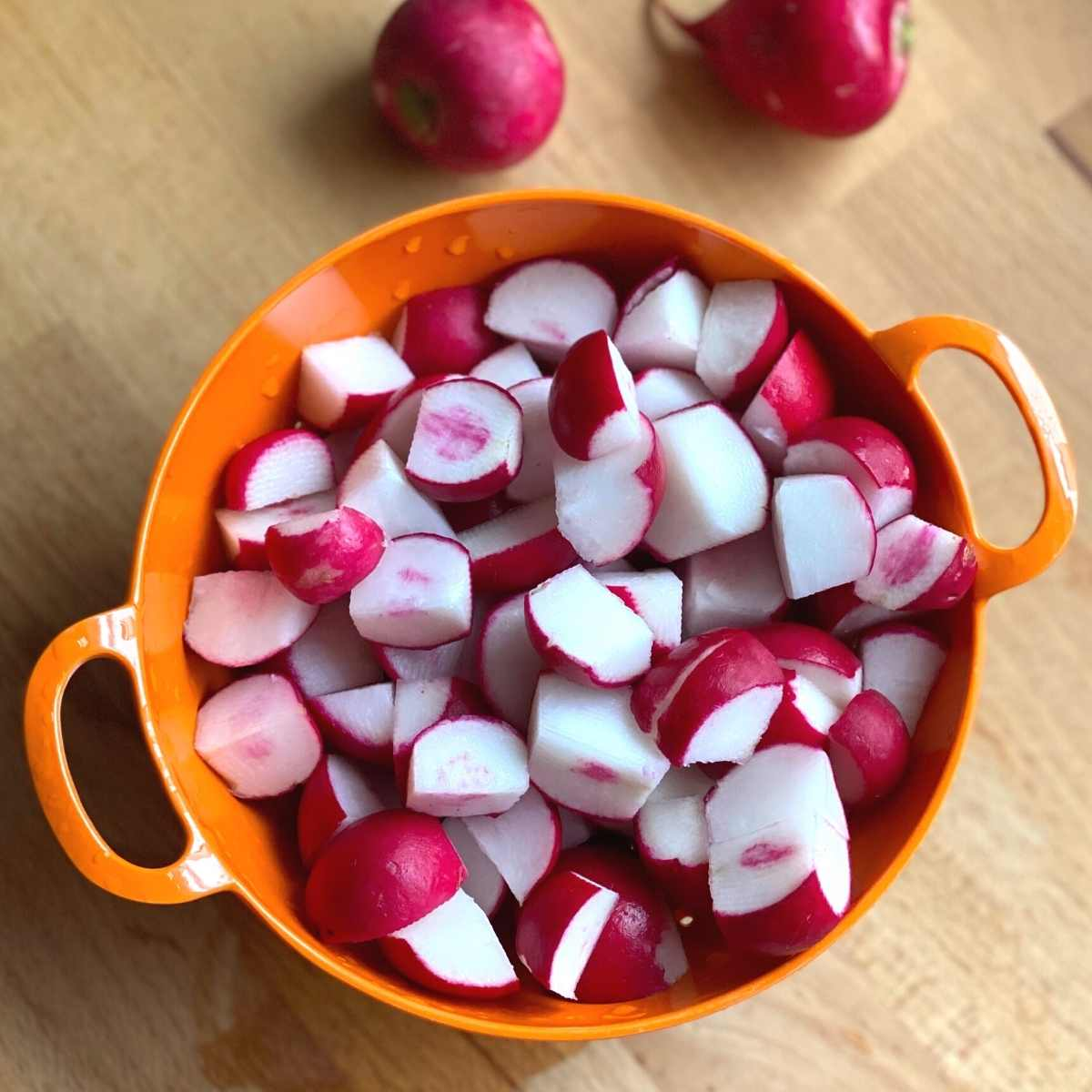 Diced radishes in a bowl.