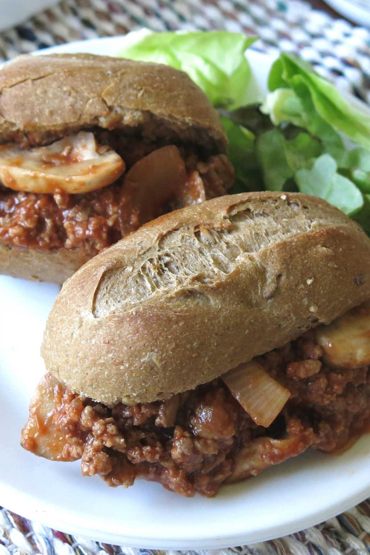 Gourmet sloppy joes in baguetts on a plate.