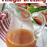 Sweet red wine vinegar dressing in a pourable container with title or recipe above it.