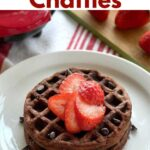 2 chocolate chaffles on plate topped with strawberries with name of recipe above it.