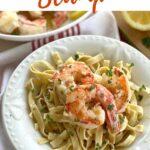 Argentine shrimp scampi over pasta with title of recipe..
