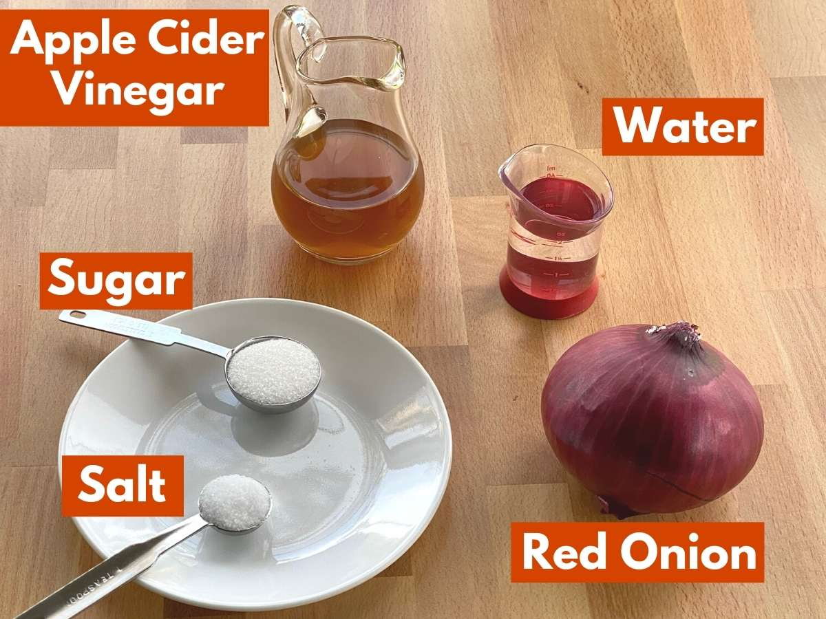 Ingredients with labels needed to make refrigerator pickled onions.
